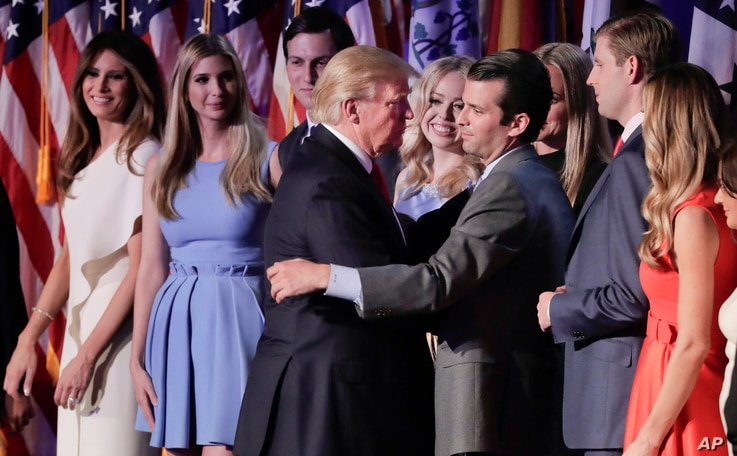President elect Donald Trump greets his son Donald Trump Jr. after giving his acceptance speech in New York.