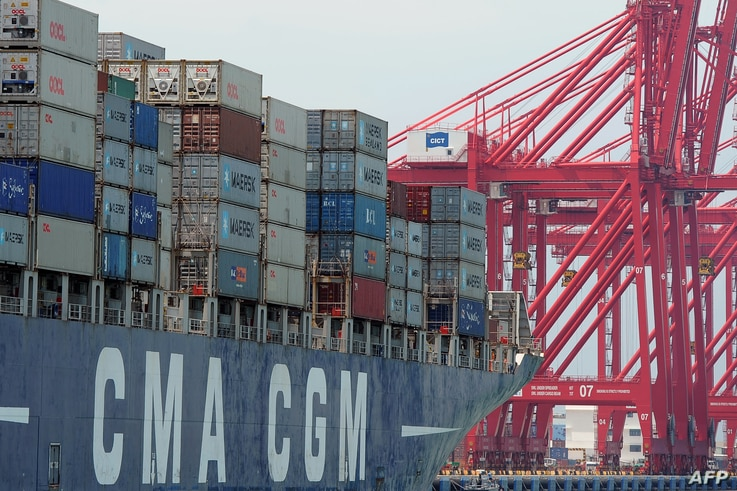 FILE - A ship loaded with containers ready for departure is seen berthed at the Chinese-majority owned Colombo International Container Terminal (CICT) in Colombo on March 30, 2016.