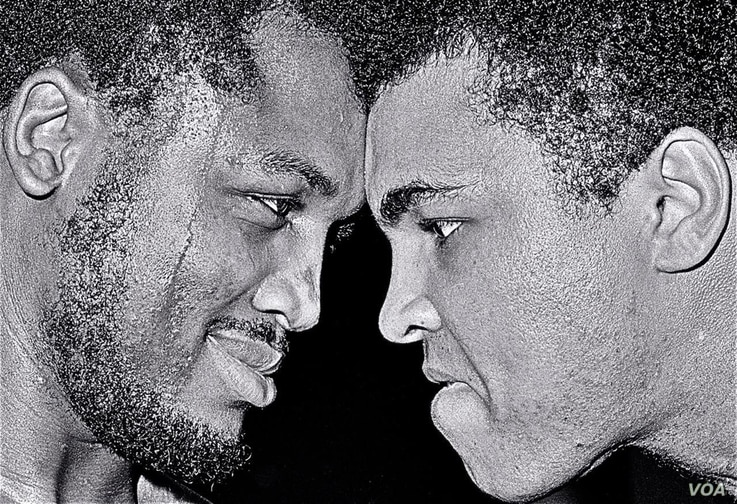 "Joe Frazier and Muhammad Ali meet face to face prior to their first bout, ""The Fight of the Century"" in 1971. (George Kalinsky)"