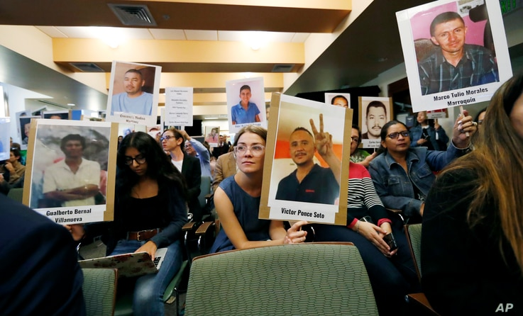 Bea Abbott, center, joins other attendees in holding up placards bearing the photographs of people who went missing while trying to cross the border from Mexico into the United States during a hearing held by the Inter-American Commission on Human Ri...