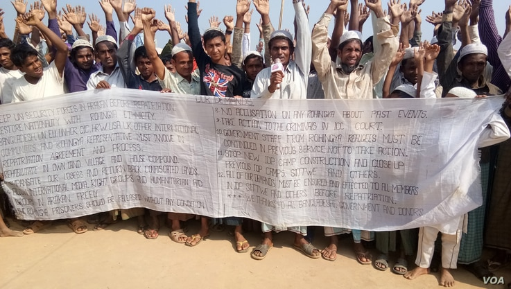 Some Rohingya refugees in Cox's Bazar, Bangladesh, are protesting against the community's repatriation to Myanmar, carrying a festoon on which their demands for repatriation are written.