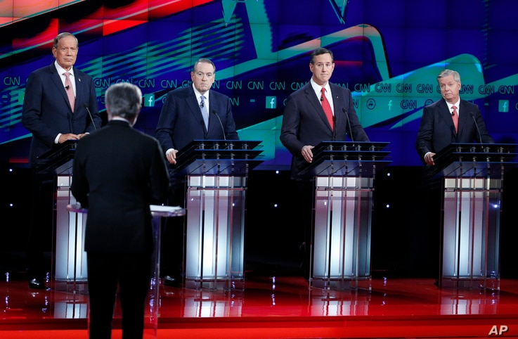Republican presidential candidates, from left, George Pataki, Mike Huckabee, Rick Santorum, and Lindsey Graham respond to moderator Wolf Blitzer during the GOP presidential debate, Dec. 15, 2015, in Las Vegas.