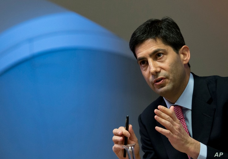 FILE - Kevin Warsh speaks to the media about his report on transparency at the Bank of England, London, Dec., 11, 2014.