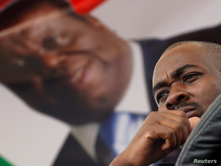 Nelson Chamisa, the new leader for Movement For Democratic Change (MDC), looks on during the funeral parade of Morgan Tsvangirai in Harare, Feb. 19, 2018.