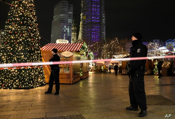 Police guard a Christmas market after a truck ran into the crowded Christmas market in Berliin Berlin, Germany, Dec. 19, 2016.