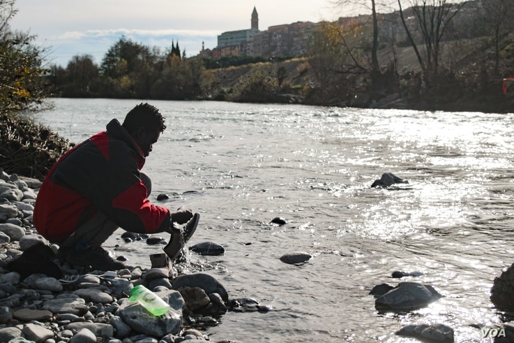 Many refugees and migrants in Ventimiglia, Italy, live near the river Roya, where they wash clothes and bathe.