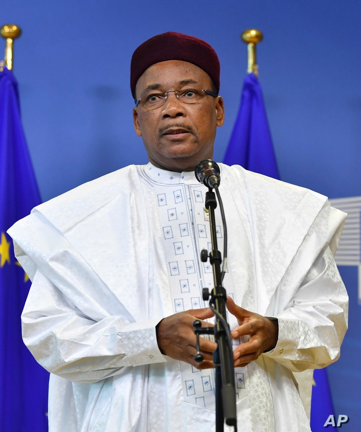 President of Niger Mahamadou Issoufou speaks with the media as he arrives for an EU-Sahel meeting at EU headquarters in Brussels on Feb. 23, 2018. m