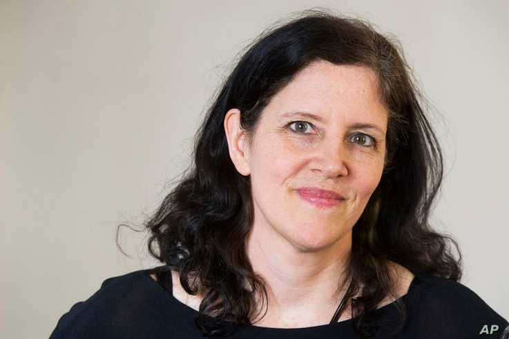 FILE - documentary filmmaker Laura Poitras poses for a portrait in New York, April 16, 2014.