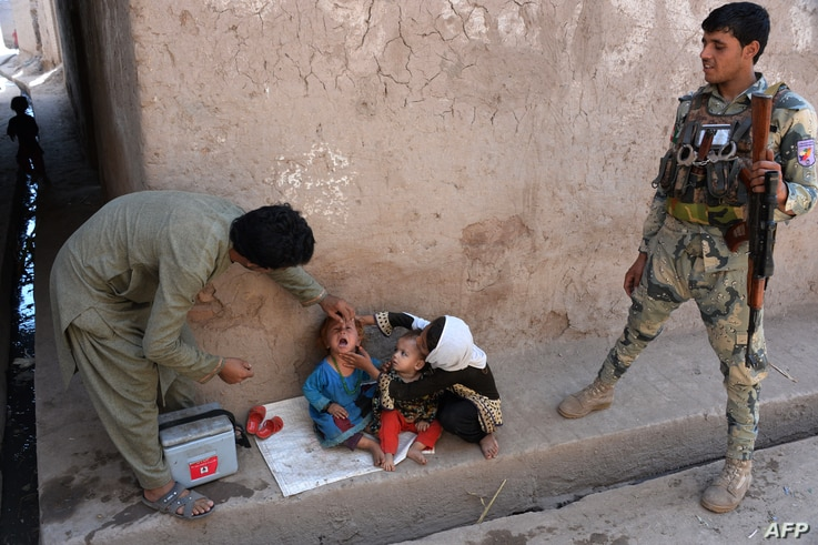 An Afghan health worker administers polio drops to a child during a polio vaccination campaign in the Surkh Rod district of Nangarhar province.