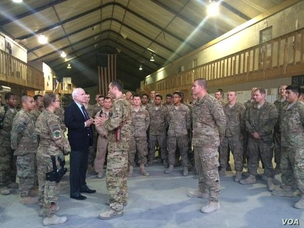 Sen. John McCain visits with members of the 41st Expeditionary Electronic Combat Squadron deployed from Davis-Monthan Air Force Base in Tucson, Arizona.