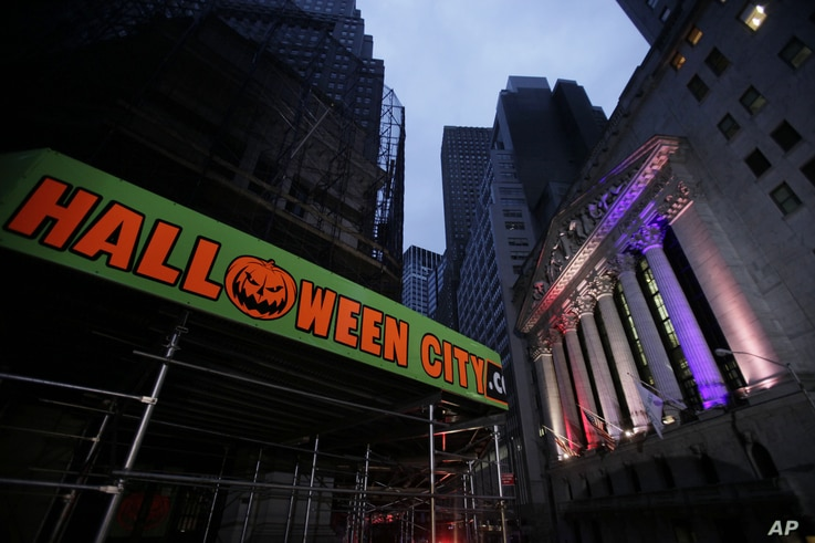 The New York Stock Exchange, right, is lit Oct. 31, 2012 before it reopens for trading following superstorm Sandy.