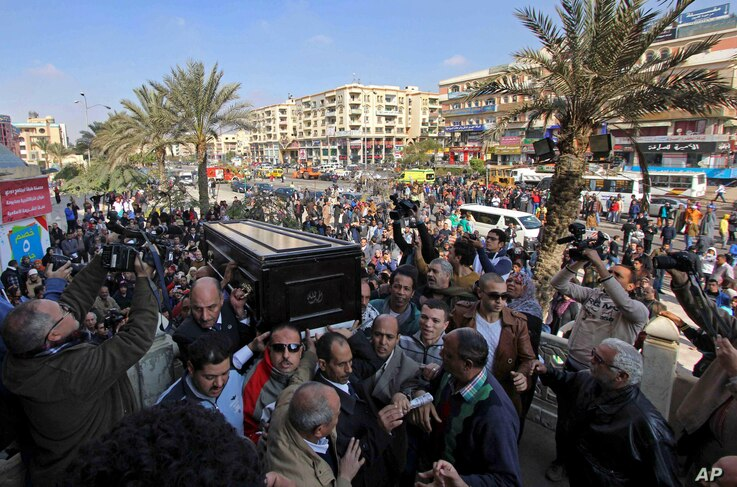 Mourners carry the coffin of Egyptian actress Faten Hamama for a funeral procession at a mosque outside Cairo, Egypt, Jan. 18, 2015.