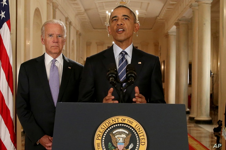 President Barack Obama, standing with Vice President Joe Biden, delivers remarks in the East Room of the White House in Washington, Tuesday, July 14, 2015, after an Iran deal is reached.