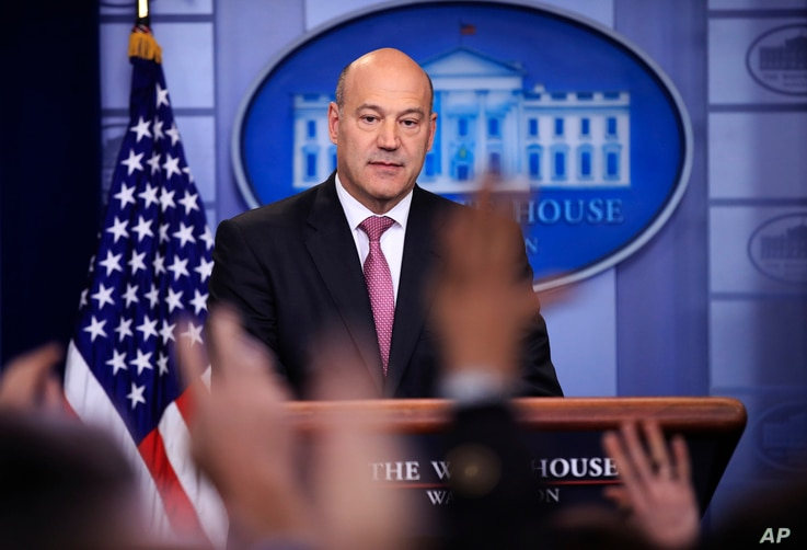 White House chief economic adviser Gary Cohn watches as reporters raise their hands to ask questions during the daily press briefing in the Brady press briefing room at the White House, in Washington, Jan. 23, 2018.