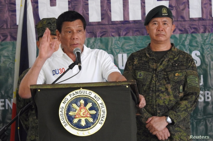 Philippines' President Rodrigo Duterte gestures as he talks to the troopers during his visit to Camp Teodulfo Bautista in Jolo, Sulu, Philippines, May 27, 2017.