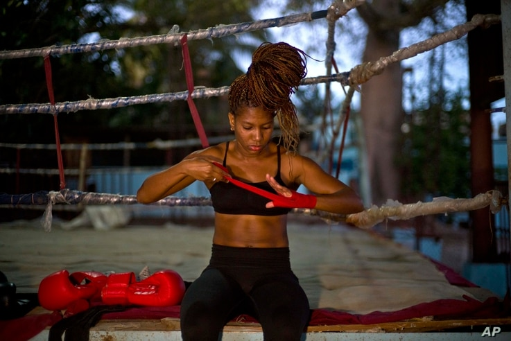 Boxer Idamelys Moreno wraps a bandage on her hand before a training session at a sports center in Havana, Cuba, Jan. 24, 2017.