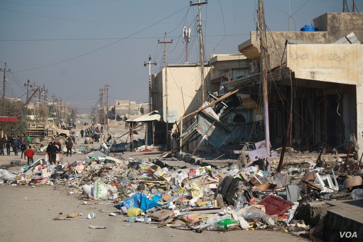 Marketplaces are often the center of neighborhoods, and when Iraqi forces take over, they base themselves in the center to secure the area, drawing IS suicide bombers and fire. At this market in the Sukkar neighborhood, the bodies of the bombers are ...