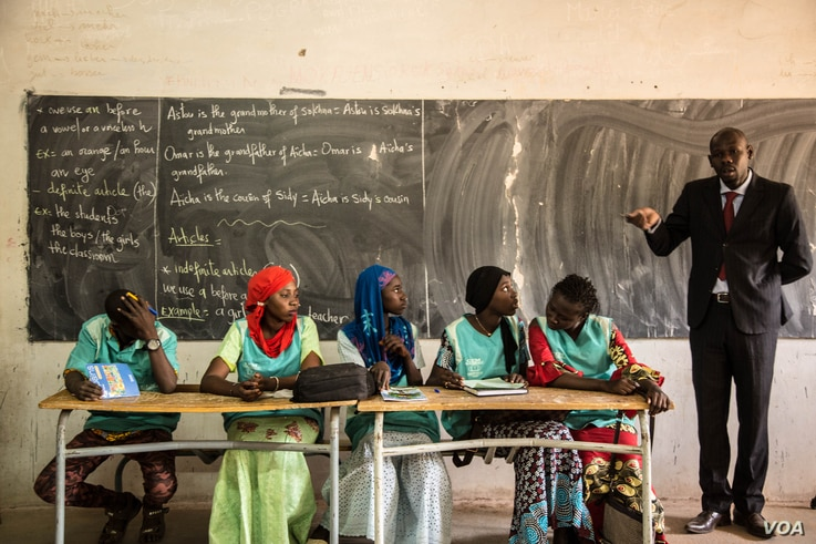 These students will help lead money savings and loaning groups in their classrooms. (Photo: Chika Oduah for VOA)