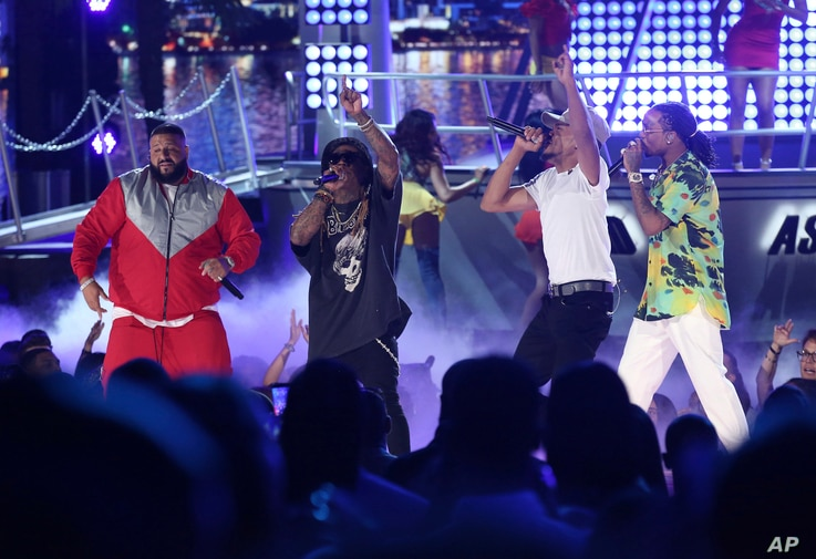 """DJ Khaled, from left, Lil Wayne, Chance The Rapper, and Quavo perform """"I'm the One"""" at the BET Awards at the Microsoft Theater on June 25, 2017, in Los Angeles."""