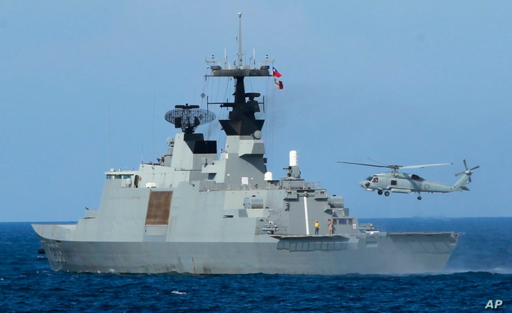 A helicopter takes off from the stern of a Taiwanese Lafayette frigate during exercises off the southern city of Kaohsiung,Taiwan, May 16, 2013.