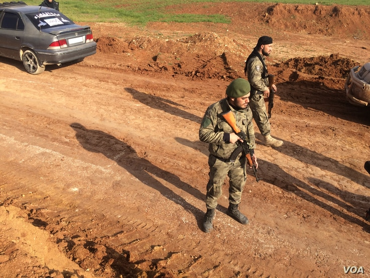 Free Syrian Army fighters are working with Turkey in their battle with Kurdish lead forces in Syria.  Pictured on Feb. 1, 2018 just outside of the Afrin region in Syria.