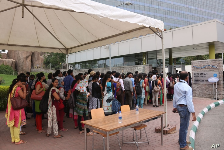 Employees queue up for security check before entering Waverock Apple development office in Hyderabad, India, May 19, 2016. Apple will set up an app design and development center in southern India, the company announced.