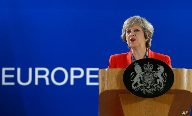 British Prime Minister Theresa May answers a question from the media during the final press briefing at the EU Summit in Brussels, Oct. 21, 2016.