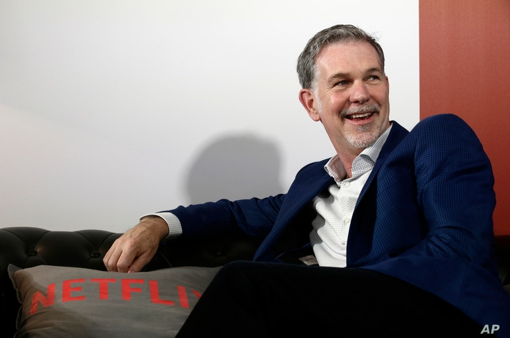 Netflix founder and CEO Reed Hastings smiles during an interview with The Associated Press in Barcelona, Spain, February 28, 2017.