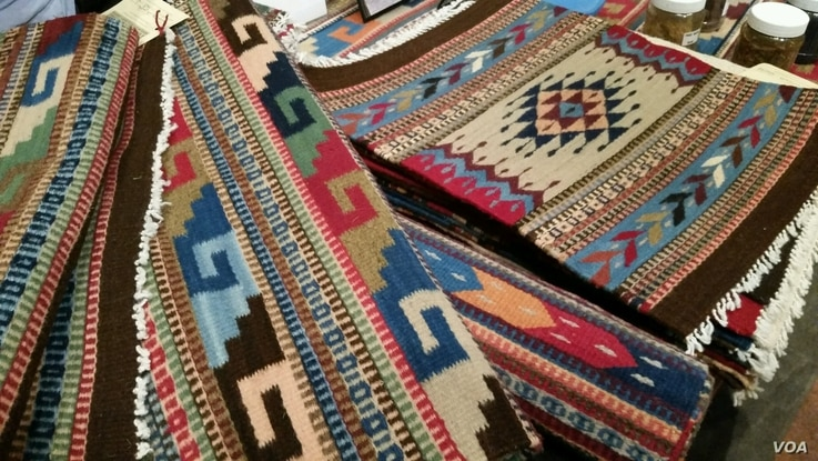 Textile artist Porfirio Gutierrez uses elements from nature to create dyes for his hand-woven rugs and tapestries. (D.Aiken/VOA)