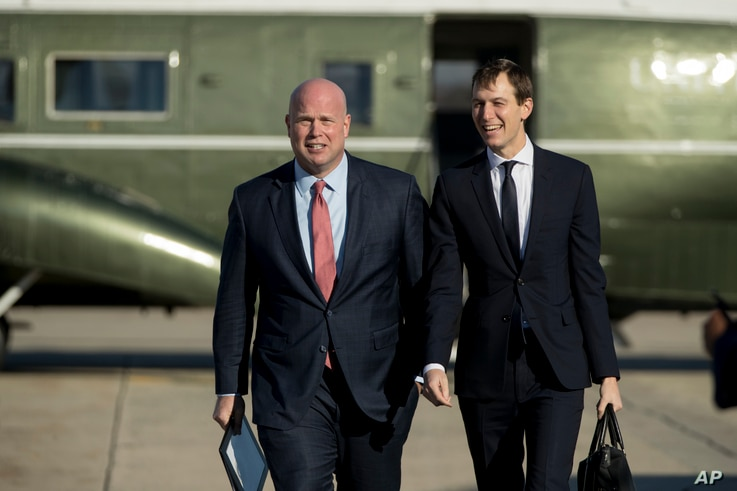 Acting United States Attorney General Matt Whitaker, left, and President Donald Trump's White House Senior Adviser Jared Kushner, right, board Air Force One at Andrews Air Force Base, Md., Dec. 7, 2018.