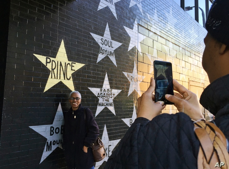 Chasity Spearman of Minneapolis takes a picture of her aunt, Ethel Smith, of Toledo, Ohio, outside First Avenue nightclub, April 21, 2017, in Minneapolis.