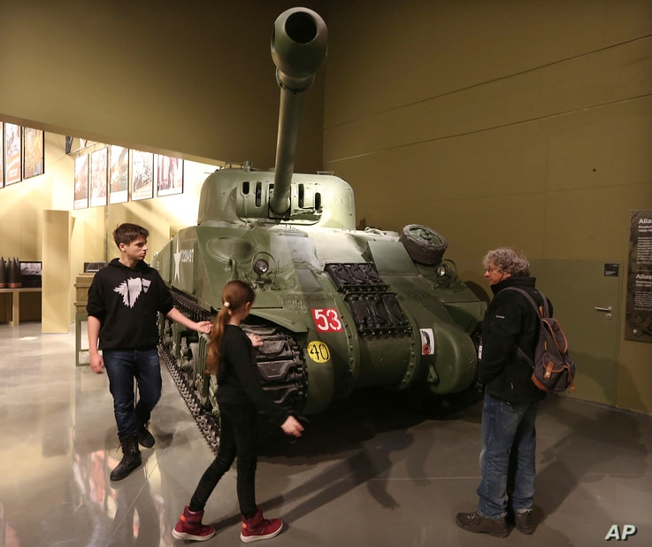 Visitors look at an exhibit in the Museum of the Second World War, which was opened for a day to historians, museums and reporters in Gdansk, Poland, Jan. 23, 2017.