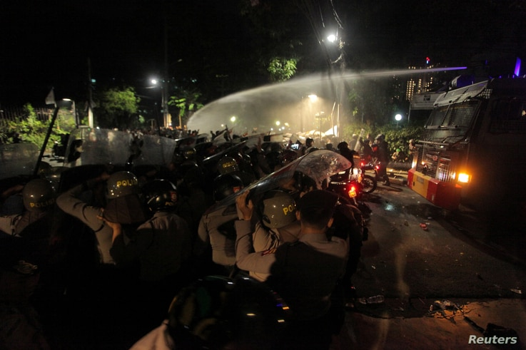 Police use a water cannon to disperse a crowd gathered outside the Indonesian Legal Aid Foundation during an anti-communist protest in Jakarta, Indonesia, early Sept. 18, 2017. Antara Foto/Muhammad Adimaja/ via Reuters