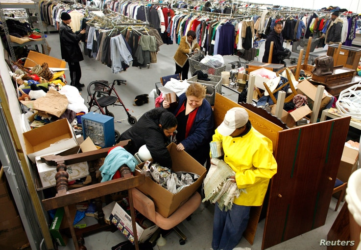 People look for clothes at the Capuchin Soup Kitchen service center in Detroit, where hundreds of people receive food and supplies every day.