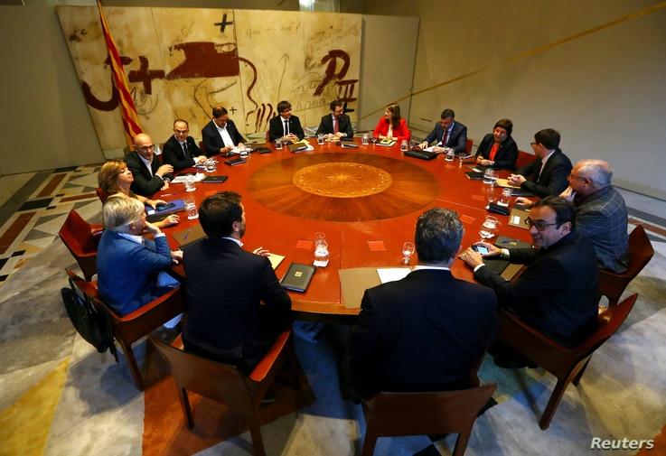 Catalan President Carles Puigdemont presides over a cabinet meeting at the regional government headquarters, the Generalitat, in Barcelona, Oct. 10, 2017.