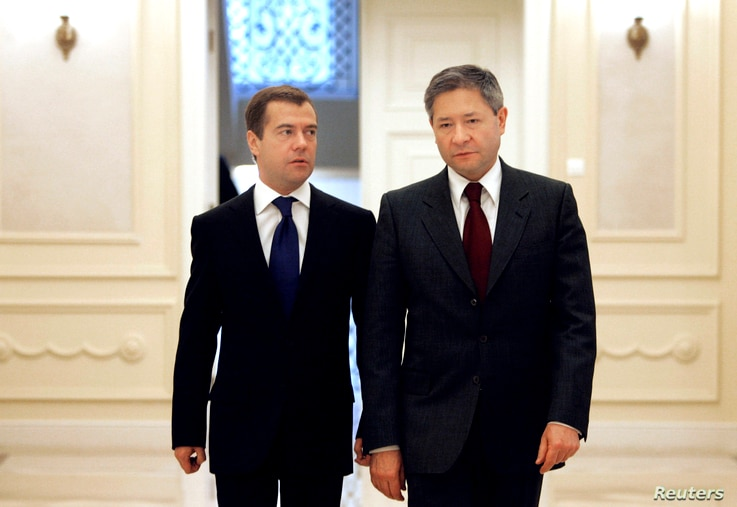 FILE - Leonid Reiman (R) Russia's communications minister at the time, is seen with then president-elect Dmitry Medvedev in Moscow, Russia, March 18, 2008. Reiman, too, is on the list of those Spanish prosecutors suspect of having ties to organized c...