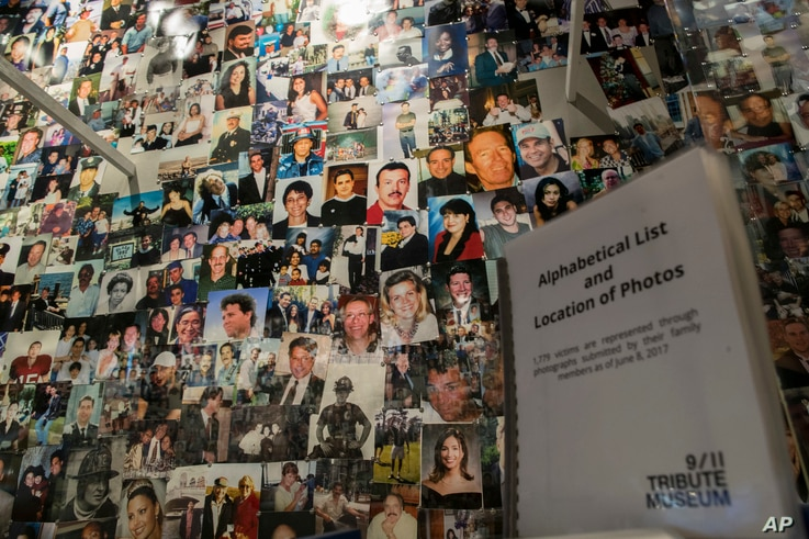 Photographs of some of those who died during the terrorist attacks on the World Trade Center, the Pentagon, and Shanksville, Pa., are on display at the 9/11 Tribute Museum in New York, June 8, 2017.