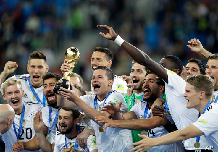 FILE - In this July 2, 2017, photo, Germany's Julian Draxler holds the trophy after winning the Confederations Cup final soccer match between Chile and Germany, at the St. Petersburg Stadium, Russia.