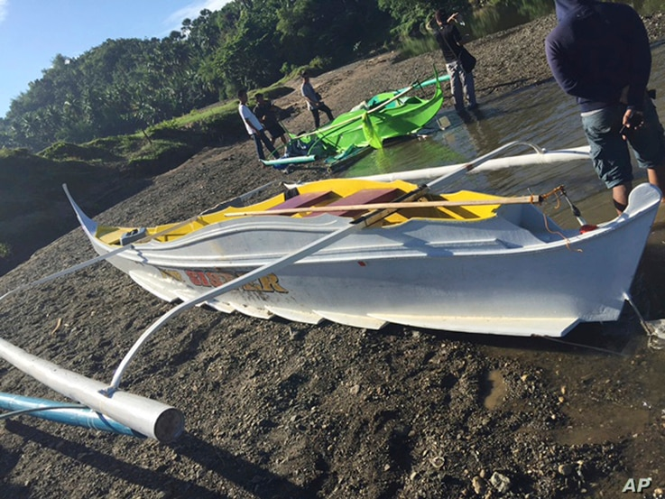 This undated photo provided by the Armed Forces of the Philippines, shows boats the military said were used by Abu Sayyaf militants to enter the Ibananga River in the central Philippines, April 12, 2017.