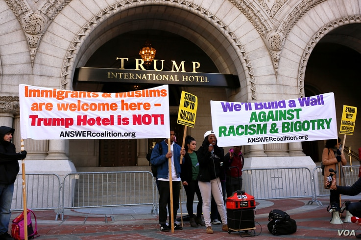Hundreds protested Donald Trump at the opening of the International Trump Hotel at the Old U.S. Post Office Building in Washington, D.C. Trump was in town for the ribbon-cutting for the luxury hotel, less than two weeks before election day. October 2...