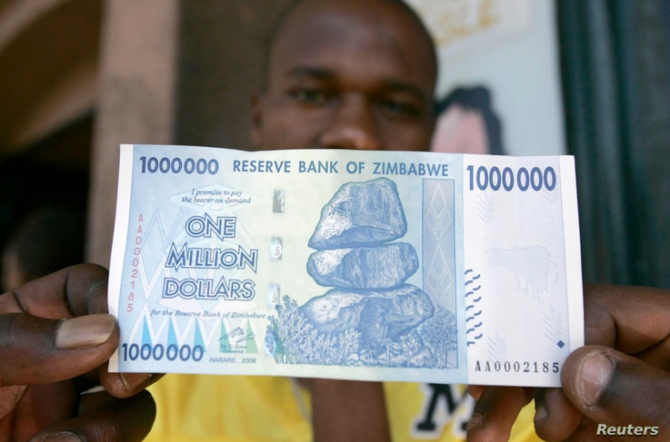 A black market foreign currency dealer displays the new $1 million banknote worth $7 on the streets of Harare, October 6, 2008.