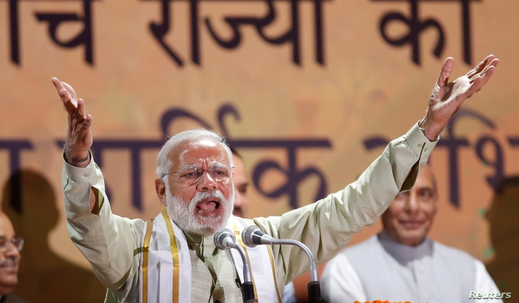 India's Prime Minister Narendra Modi addresses his supporters at Bharatiya Janata Party (BJP) headquarters in New Delhi, India, March 12, 2017.