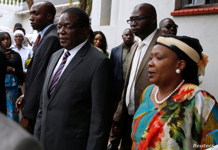 Zimbabwean President Emmerson Mnangagwa and his wife Auxillia arrive to pay their respects at the home of Movement For Democratic Change (MDC) leader Morgan Tsvangirai in Harare, Zimbabwe, Feb. 18, 2018.