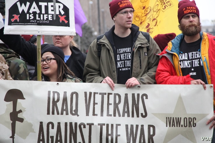 Protesters speak out against the war — and in support of water — as Donald Trump is sworn-in as the 45th President of the United States in Washington, D.C., Jan, 20, 2017. (Victoria Macchi/VOA)