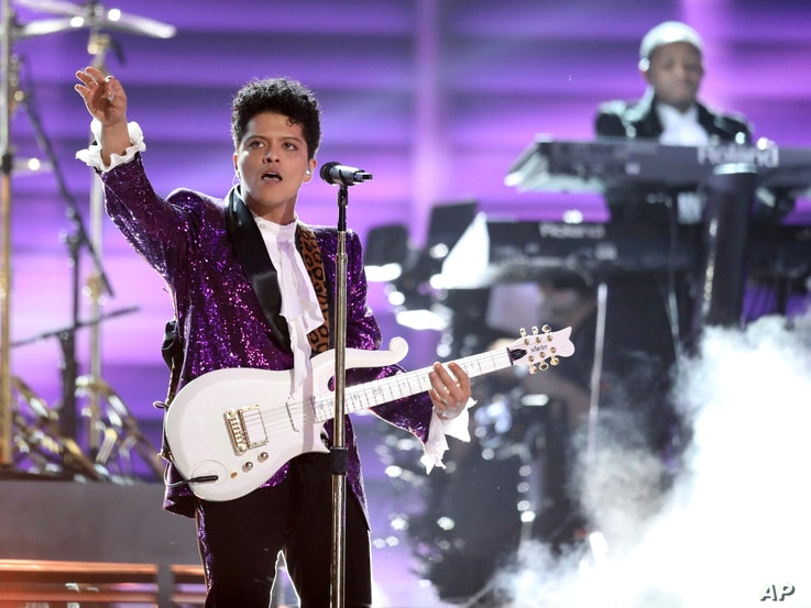 "Bruno Mars performs ""Let's Go Crazy"" during a tribute to Prince at the 59th annual Grammy Awards on Feb. 12, 2017, in Los Angeles."