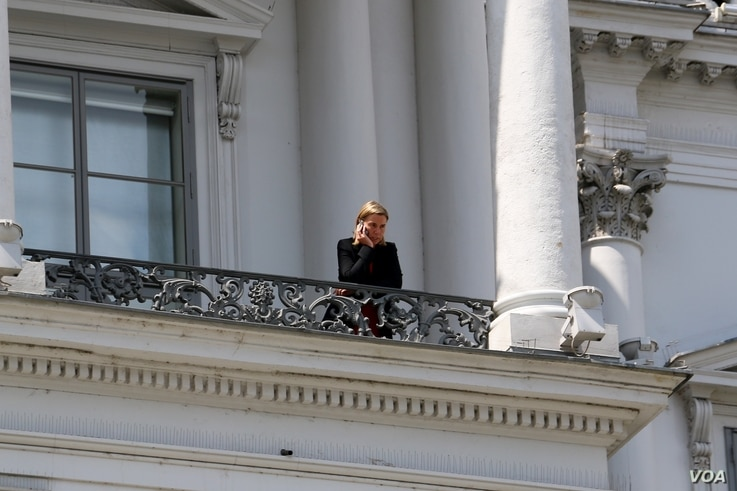European Union foreign policy chief Federica Mogherini takes a break on a balcony at the Palais Coburg hotel in Vienna, Austria, July 10, 2015.