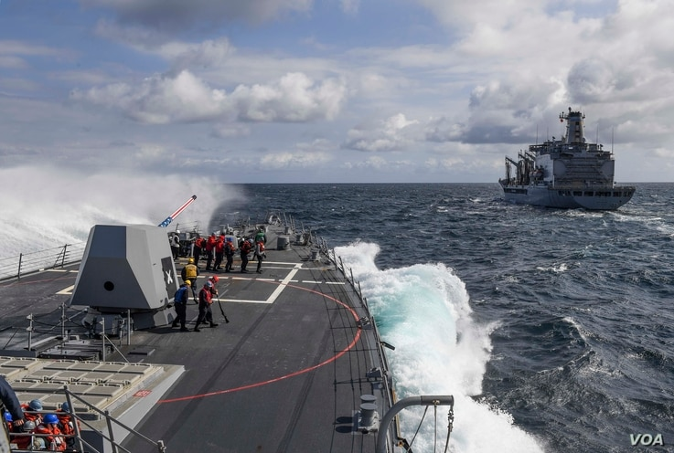 A wave breaks on the forecastle of the Arleigh Burke-class guided-missile destroyer USS Wayne E. Meyer as the ship begins its approach to the fleet replenishment oiler USNS Rappahannock for a replenishment-at-sea in the western Pacific region. The U....