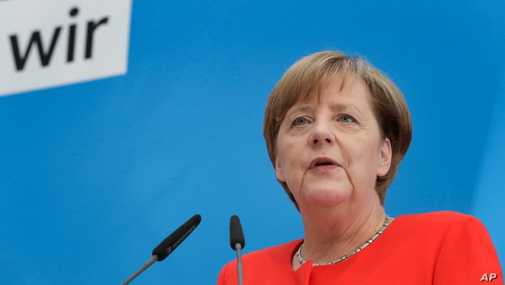 German Chancellor and Christian Democratic Union, CDU, party chairwoman Angela Merkel addresses the media during a joint press conference with Bavarian state governor and Christian Social Union, CSU, party chairman Horst Seehofer, in Berlin, Germany,...