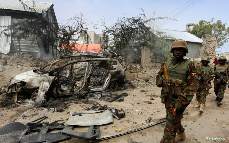 Ugandan soldiers serving in the African Union Mission in Somalia (AMISOM) patrol in a formation near the Jilacow underground cell inside a national security compound after an attack by suspected militants in Mogadishu August 31, 2014. Islamist rebels...