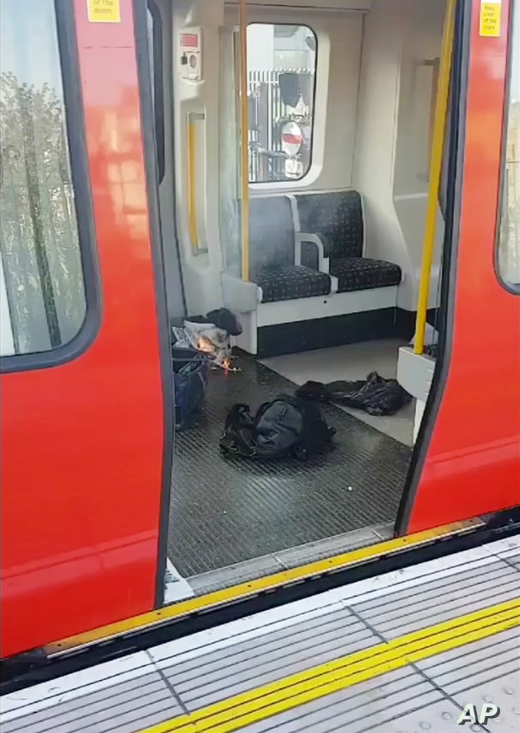 This is an image made from video showing burning items in underground train at the scene of an explosion in London Friday, Sept. 15, 2017.